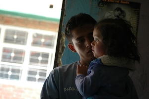 Jainober, 23, with his 2-year-old daughter Karen Dayana in his home in Bogota. His family has been displaced.