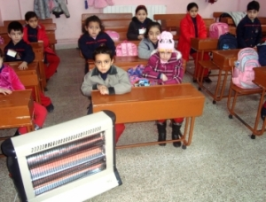 Electrical stoves purchased with Mennonite Central Committee funds help to keep the children warm as they attend National Evangelical School in Homs, Syria. (Photo courtesy of National Evangelical School)