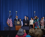 President Barack Obama speaks about the  importance of expanding the protections of the Violence Against Women Act. He is joined on stage by politicians, women's rights activists, and native american rights activists. This signing of the Violence Against Women Act into law took place on March 7, 2013. (Photo Jesse Epp-Fransen/MCC)