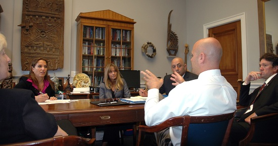 Marc Ediger (back to camera), a lieutenant with the Reedley (Calif.) Police Department, meets with a congressional staffer to describe preventive and restorative approaches to public safety shared by the city of Reedley, West Coast Mennonite Central Committee and other partners.