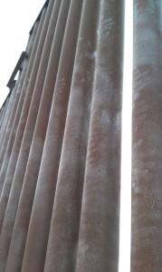 Dusty handprints left by those who climbed over a segment of the border fence near Naco, Arizona.