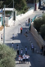 Children play in the street at the Lajee Center, an MCC partner in the Aida Refugee Camp, a United Nations refugee camp north of Bethlehem in the West Bank