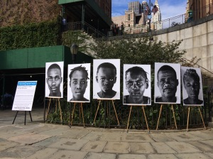 Faces of cholera victims on display near the United Nations in New York for the launch of Face | Justice campaign.
