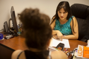 Rachel Díaz, a consulting attorney for MCC East Coast's immigration program, meets with a client at the MCC office near Miami. Díaz's work seeks to keep families together.