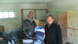 MCCer Joe Manickam giving blankets to a partner in the DPRK