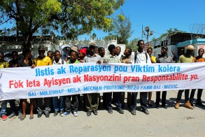 Cholera victims and families demand justice in Port-au-Prince during a peaceful protest at the UN log base.