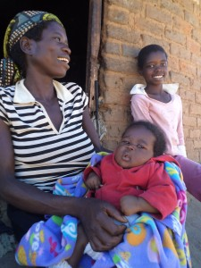 At Mtshabezi Mission Hospital in Zimbabwe, MCC is helping mothers get the medical care they need and avoid passing HIV on to their newborn babies. Sipho Ncube began receiving care for HIV at the hospital before her 3-year-old daughter Privilege was born. Ncube, holding baby Quincy, is pictured with daughter Princess. (MCC Photo/Richard Ndlovu)