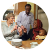 Idris Fikak and Khadija Fikak, enjoyng coffee and snacks at the home of Forest Grove Community church members in Saskatoon 2013. Forest Grove worked with MCC to sponsor the Fikak family who arrived in 2013. MCC Photo/Matthew Sawatzky